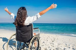 Image of a Woman in a Wheelchair on the Beach