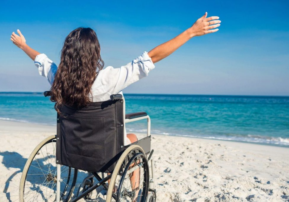 WomanInWheelchairOnBeach